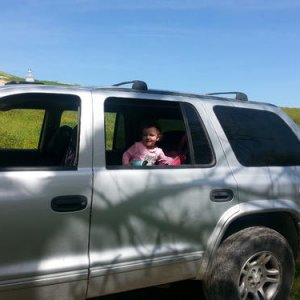 My daughter hanging out in the truck at one of our stopping points.